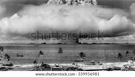 The BAKER test of Operation Crossroads, July 25, 1946. Seconds after the water column rose, and formed a condensation cloud, it fell back, unleashing a billowing base surge forming a 500 foot high wal - stock photo