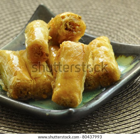 The baklava, an arabic dessert made of thin pastry, nuts. - stock photo