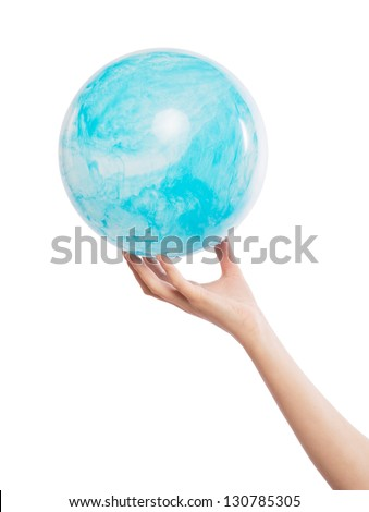 The ball is in the form of land in the hands - stock photo