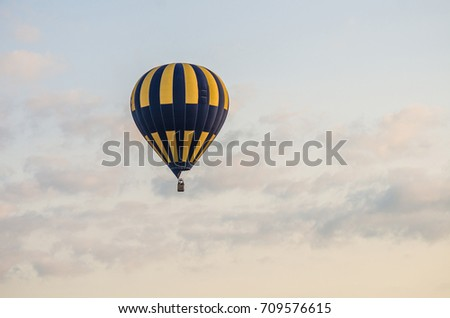 The balloon is flying in the sky