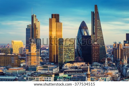 The bank district of central London with famous skyscrapers and other landmarks at sunset with blue sky - London, UK - stock photo