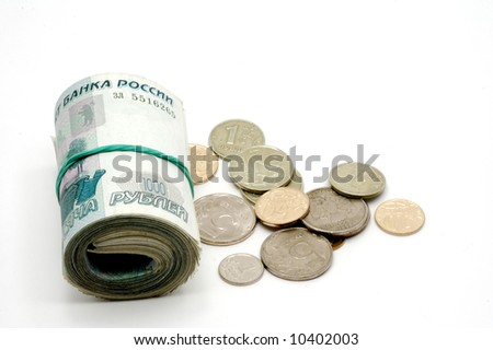 The banknotes braided in a roll and coins on a white background