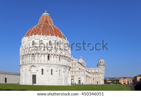 The Baptistry and the Leaning Tower in Cathedral Square in Pisa, Italy - stock photo