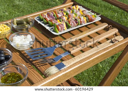 The barbecue set w the meat on the spits - stock photo