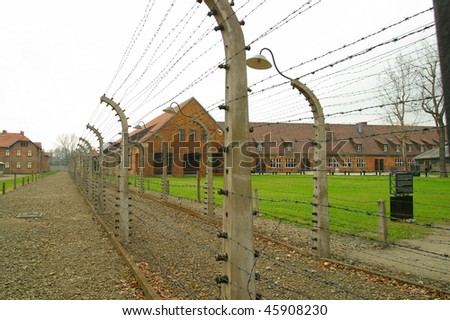 The barbed wire fence at Auschwitz concentration camp Oswiecim P - stock photo