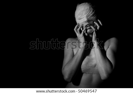 The bared girl wound with bandage emotional portraits on a black background