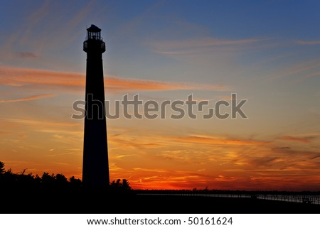 The Barnegat Lighthouse, just after sunset. - stock photo