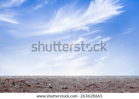 the barren ground with blue sky clouds background. - stock photo