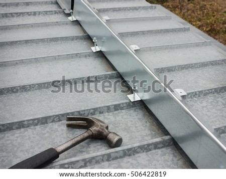 The barrier for snow guard on the edge of a metal roof