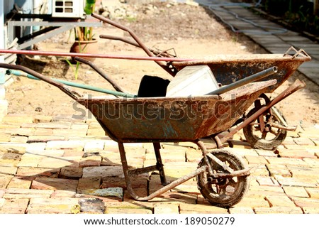 The barrow on the pathway - stock photo