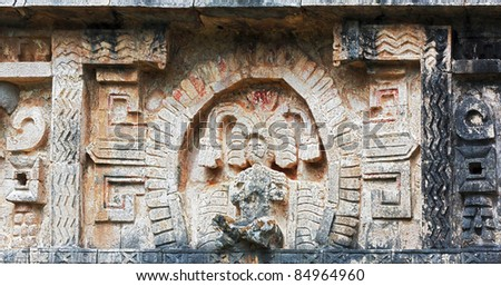 The bas-relief on the wall of the palace in Chichen Itza, Mexico - stock photo