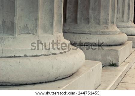 The base of white marble columns. - stock photo