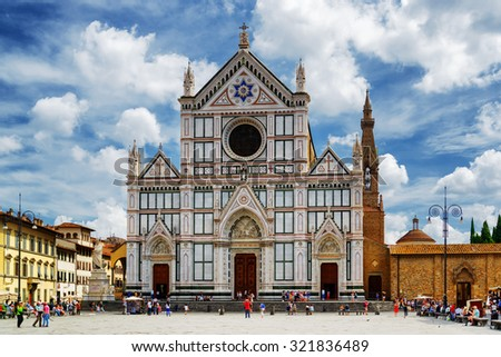 The Basilica di Santa Croce (Basilica of the Holy Cross) on square of the same name in Florence, Tuscany, Italy. Florence is a popular tourist destination of Europe. - stock photo