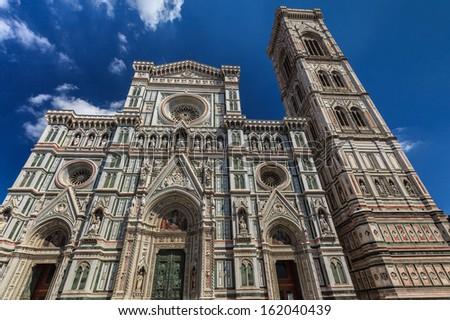 The Basilica di Santa Maria del Fiore and Giotto's Campanile - famous landmarks of Florence in Italy - stock photo