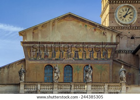 The Basilica of Our Lady in Trastevere is a titular minor basilica, one of the oldest churches of Rome. Facade of church - stock photo