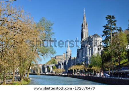 The Basilica of Our Lady of the Immaculate Conception is a Roman Catholic church and a minor basilica in Lourdes. It was built on top of the rock above the Grotto. - stock photo