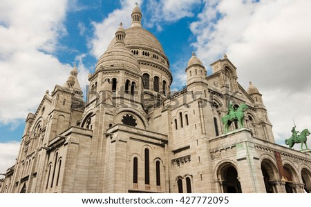The basilica Sacre Coeur is a Roman catholic church located at the summit of the butte Montmartre , the highest point in Paris. - stock photo