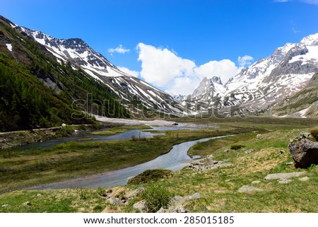 The basin of Combal in Val Veny with Pyramides Calcaires and the Aiguille de l'Estellet - stock photo