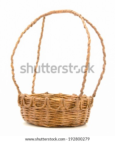 The basket made of waste paper isolated