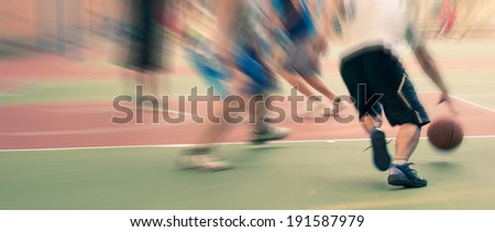 The basketball match in the campus - stock photo