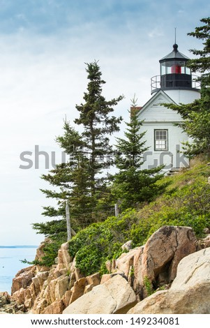 The Bass Harbor Light Station was built in 1858 and is one of several working stations around the Mount Desert Island in Maine. - stock photo