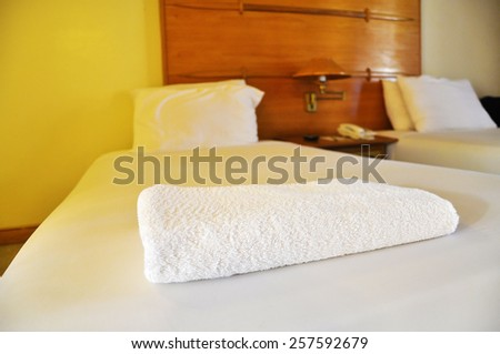 The Bath towels on the bed of hotel bedroom - stock photo
