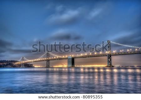 The Bay Bridge at dusk - stock photo