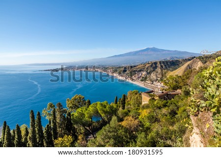 The bay of Giardini-Naxos with the Etna and Catania in the background viewed from Taormina, Sicily Italy. An HDR picture