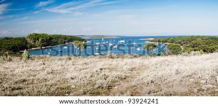 the bay with boats in Kamenjak - near Premantura, 13 km by Pula - stock photo