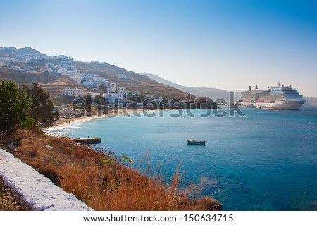 the beach against the backdrop of the Mediterranean Sea and the cruise liner. - stock photo