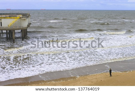 The beach and pier in The Hague. Netherlands. Den Haag - stock photo