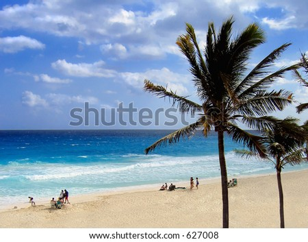 The beach at Cancun is sunny, unspoiled and beautiful - stock photo