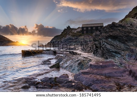 The beach at Polperro a small historic fishing village on the south coast of Cornwall - stock photo