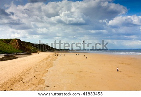 The beach at saltburn with kite flyers - stock photo