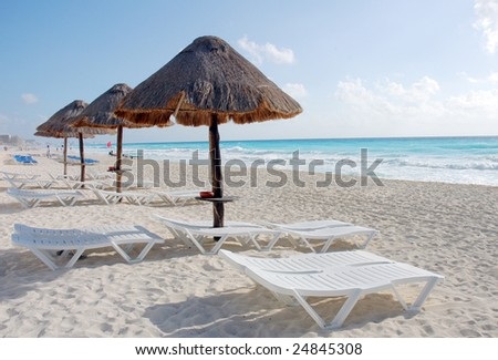 The beach by the Carribean sea in Cancun Mexico - stock photo