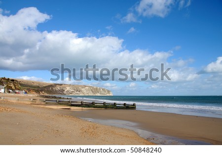 The beach in Swanage, Dorset (UK), on a bright sunny day - stock photo