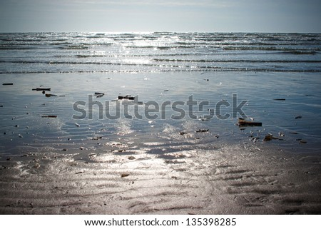 The beach scenery, with sun reflected on the water that create sparkles - stock photo