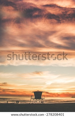 The Beach Tower. California Beach Sunset and the Lifeguard Tower. United States. - stock photo