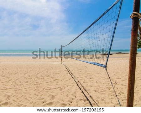 The beach volleyball net on a sunny day with blue sky - stock photo