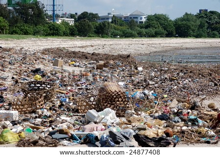 The beach with a lot of trash - stock photo