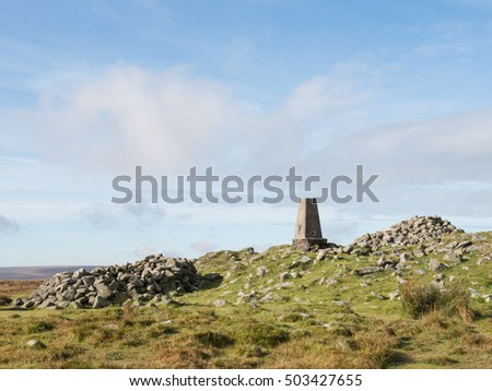 The Beacon and Trig Point on the Summit of Cosdon Hill, one of the High Points on Dartmoor National Park in Devon, England, UK
