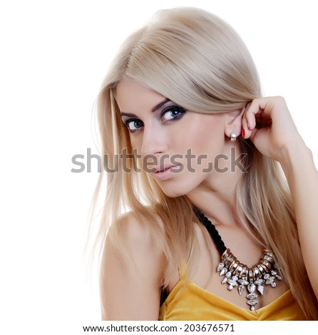 The beautiful blond woman in expensive pendant close-up - stock photo