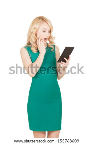 The beautiful blonde in a green dress with a tablet in a hand - stock photo