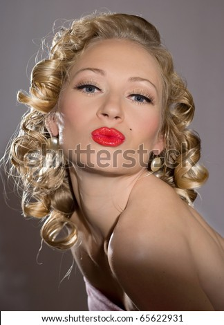 The beautiful blonde  woman with bright red lipstick