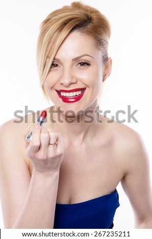 the beautiful  blonde woman with lipstick isolated on the white background - stock photo