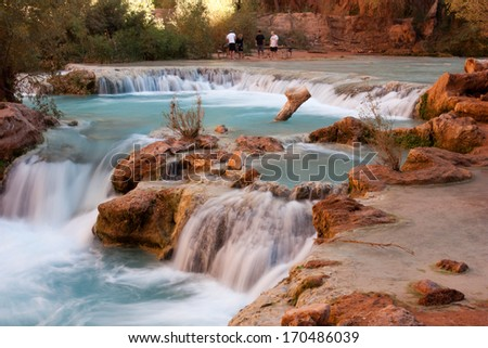 The beautiful blue waters and travertine pools surrounding Havasu Falls, near Grand Canyon, Arizona - stock photo