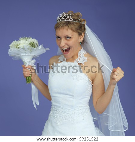 The beautiful bride in a white dress shouts with happiness - stock photo