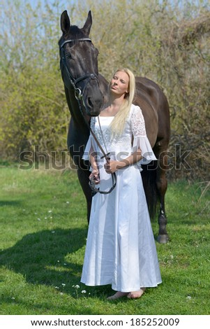 The beautiful bride with a horse. Horsewoman. - stock photo