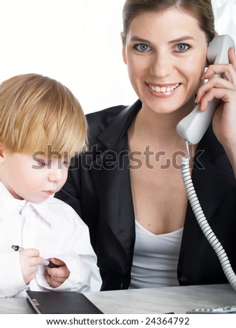 The beautiful businesswoman in a black jacket and boy - stock photo