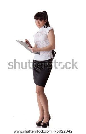 The beautiful businesswoman stands with a clipboard in hands on a white background.